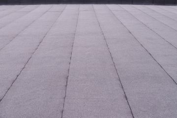 Flat roof in Beach City by M Roofing, LLC